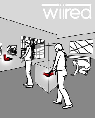 Madleen Sklenar | Mobile Pico Projection  ...ist ein Leitsystem für Ausstellungen oder Museen, welches auf dem Prinzip des heißen Drahts beruht. Mit einer Kombination aus Mini-Beamer und Wii Remote bewegt man sich durch den Raum von einem Ausstellungsstück zum nächsten. Man folgt dem heißen Draht und versucht, die Informationen, die sonst auf Tafeln direkt neben den Ausstellungsstücken stehen, im Raum zu finden. Dabei kann es sein, dass sich die Wege aufteilen und man sich entscheiden muss, in welche Richtung es weitergehen soll. Die Bildbeschreibungen werden nicht immer an den Wänden finden sein. Tische, Bänke, der Boden, praktisch der ganze Raum wird in das Leitsystem mit einbezogen.