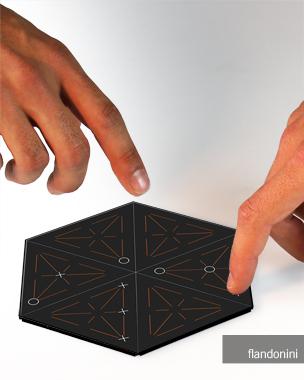 // 5dots ist ein Spiel für das hexaphone, ein Smartphone mit sechseckiger Grundform, für 2 Spieler. Das Spielziel fünf Punkte in einer Reihe zu erreichen klingt simpel. Das Spielfeld aus 6 einzelnen dreieckigen Screens verändert jeder Spieler nach jedem Zug durch das Drehen eines Bildschirm-Moduls und schafft damit eine neue Ausgangssituation für seinen Gegenspieler. Er kann das Spielgeschehen somit sowohl durch Interaktion auf dem Screen als auch mit den einzelnen Bildschirmelementen beeinflussen.  // Anne Hofmeister // BA 3.Semester ID